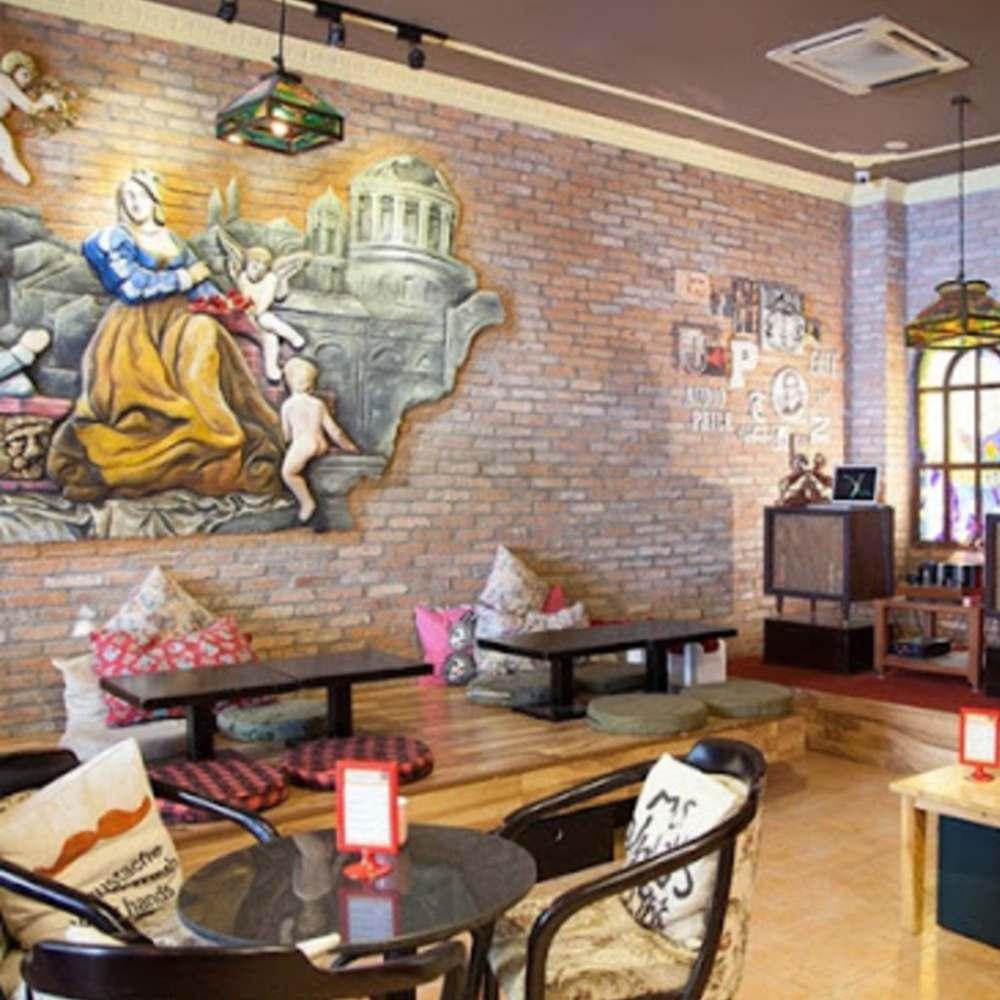 tranh vẽ tường trang trí quán cafe nghệ thuật